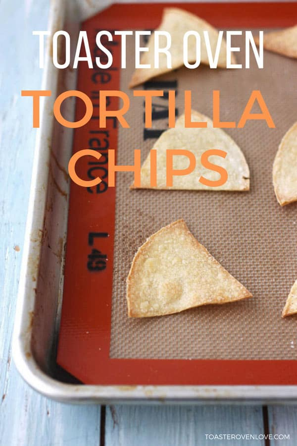Baked tortilla chips on a silicone baking mat.