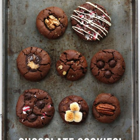 Chocolate cookies in eight flavors on a baking sheet.