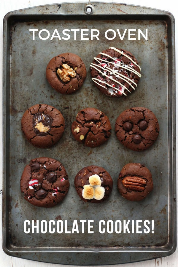 Toaster oven chocolate cookies in eight flavors on a baking sheet.