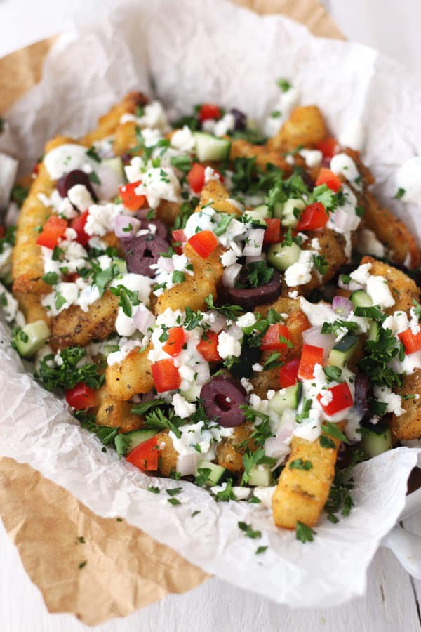 Baked fries loaded with feta, tomatoes, olives, and parsley.