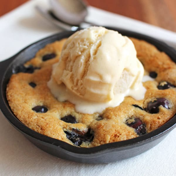 Blueberry Lemon Skillet Cookie for Two has fresh squeezed lemon, honey and whole grains baked up in a tiny skillet cookie bursting with fresh blueberries. Don't forget the ice cream!