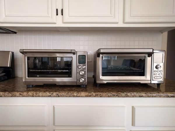 Two large toaster ovens on a kitchen counter.