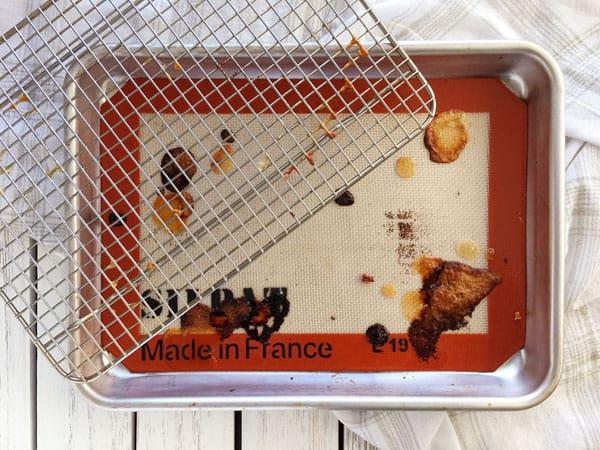 Dirty quarter sheet pan, baking rack and silicone baking mat.
