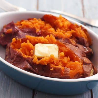 Baked sweet potato with butter in a baking dish