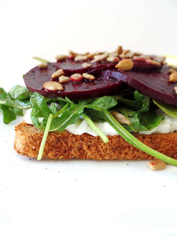 Roasted Beet and Cottage Cheese Toast on a white table.