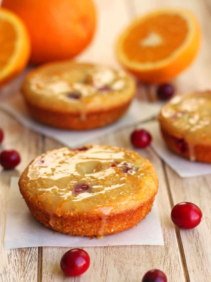 Cranberry Orange Cornbread Donuts are hearty donuts filled with tart cranberries, tangy buttermilk and toothy cornmeal. Drizzle your baked donuts with a honey sweetened orange glaze for a delicious less than 200 calorie toaster oven treat!