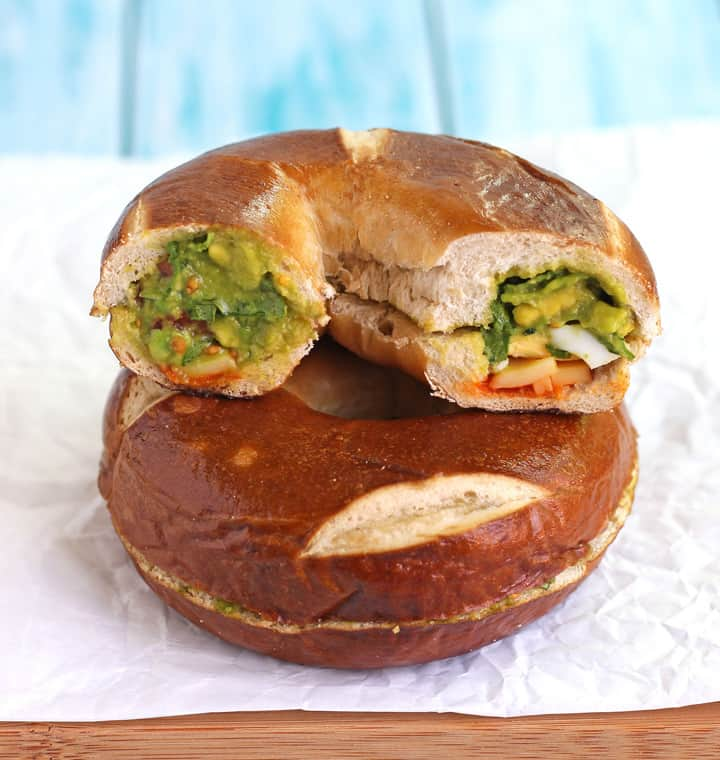 Make breakfast fun with a Hidden-Egg Bagel Sandwich. Fill a hollowed out bagel with a donut pan baked egg, veggies, cheese and spicy sriracha sauce for a tasty mess-free back to school breakfast or lunch.