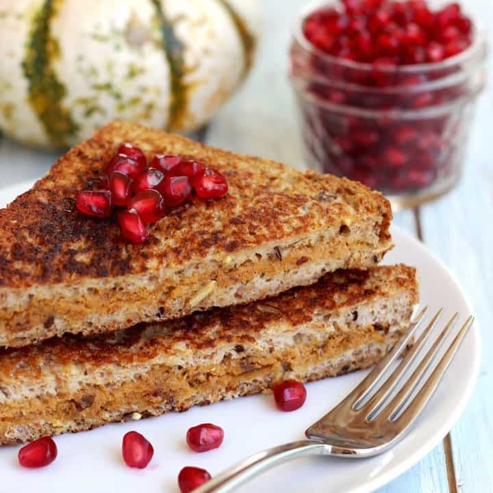 Stuffed french toast topped with pomegranate seeds.