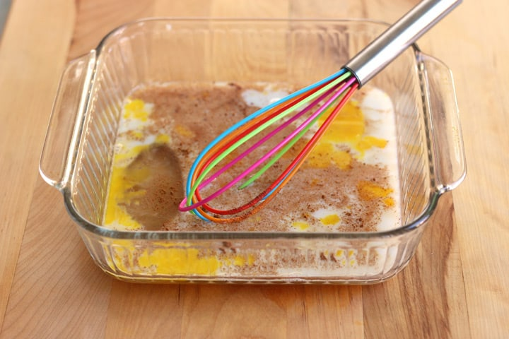 Custard mixture whisked in a baking dish.