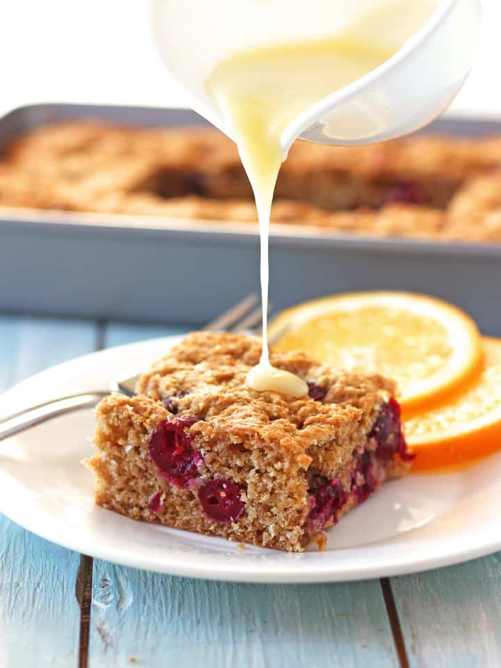White Chocolate Cranberry Orange Snack Cake. The perfect potluck treat. Your coworkers will be fighting over the last piece of this tasty whole grain snack cake. Less than 200 calories in each generous serving including the white chocolate glaze!