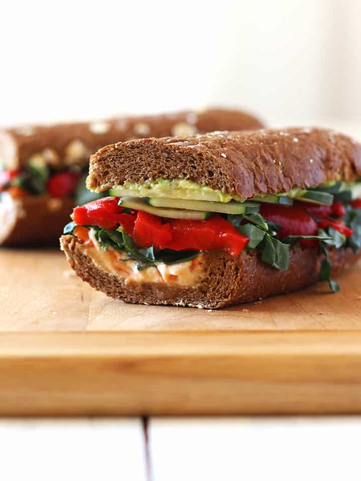 Whole grain baguette layered with hummus, avocado and fresh veggies.