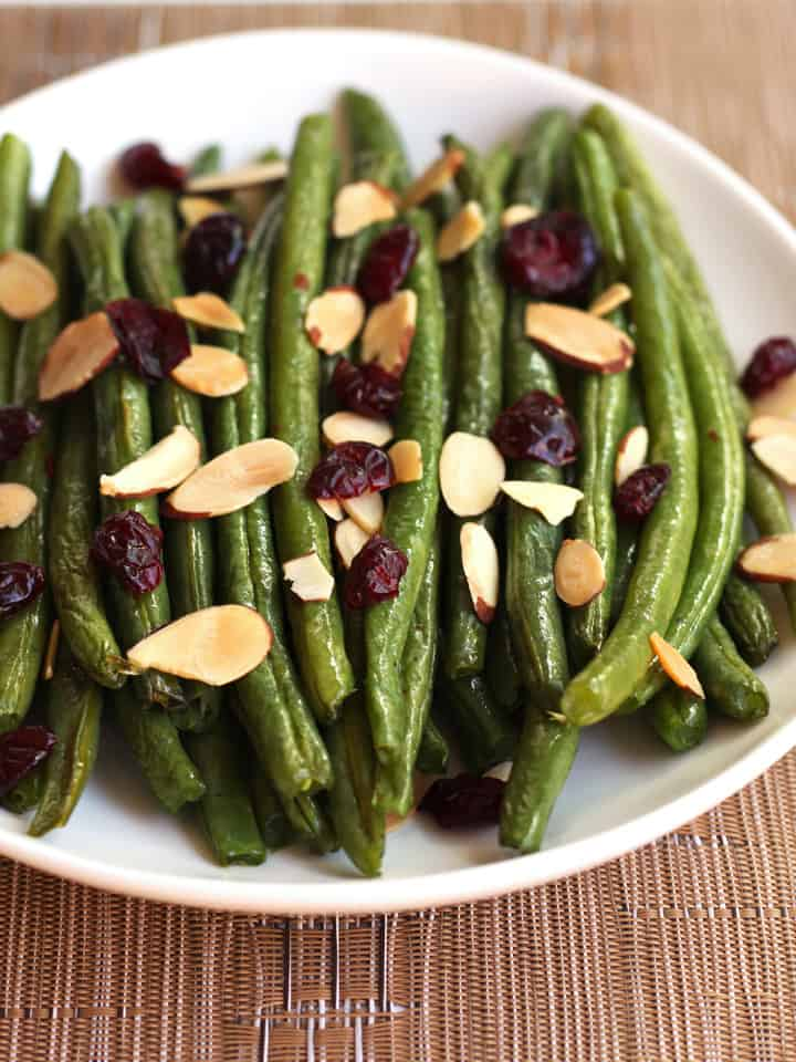 Roasted green peans with toasted nuts and dried cranberries.