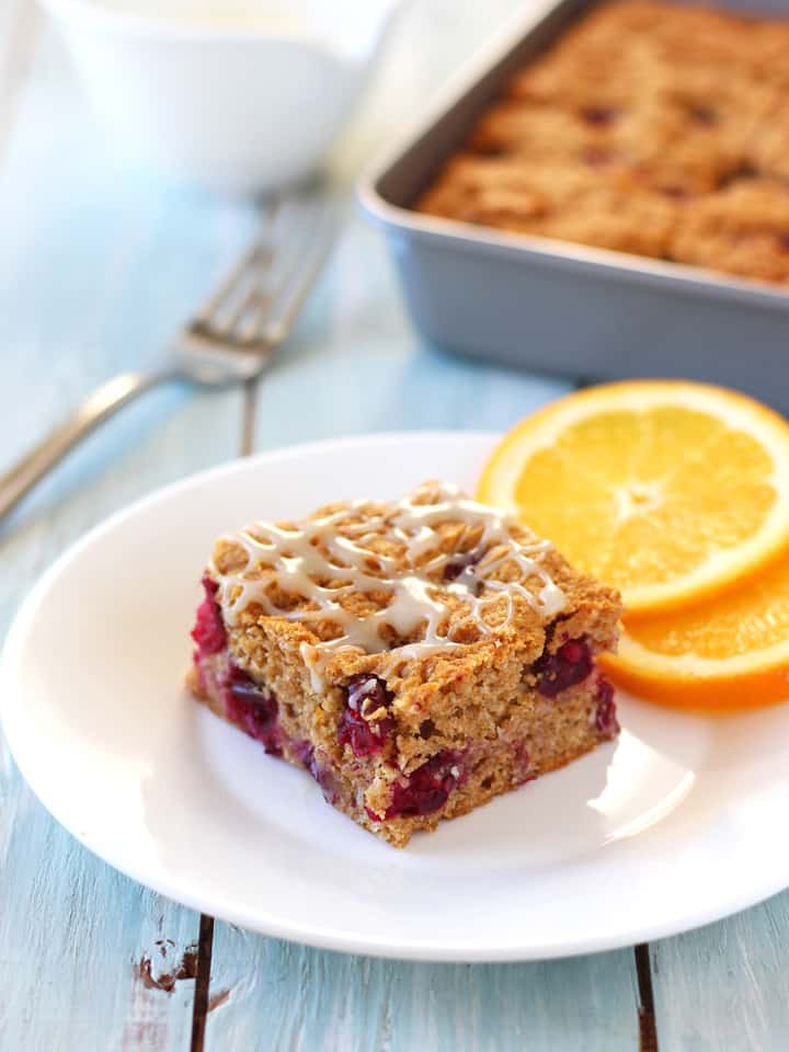 White Chocolate Cranberry Orange Snack Cake. Be a hit at your next office potluck with this simple cranberry orange snack cake drizzled with a rich white chocolate glaze.