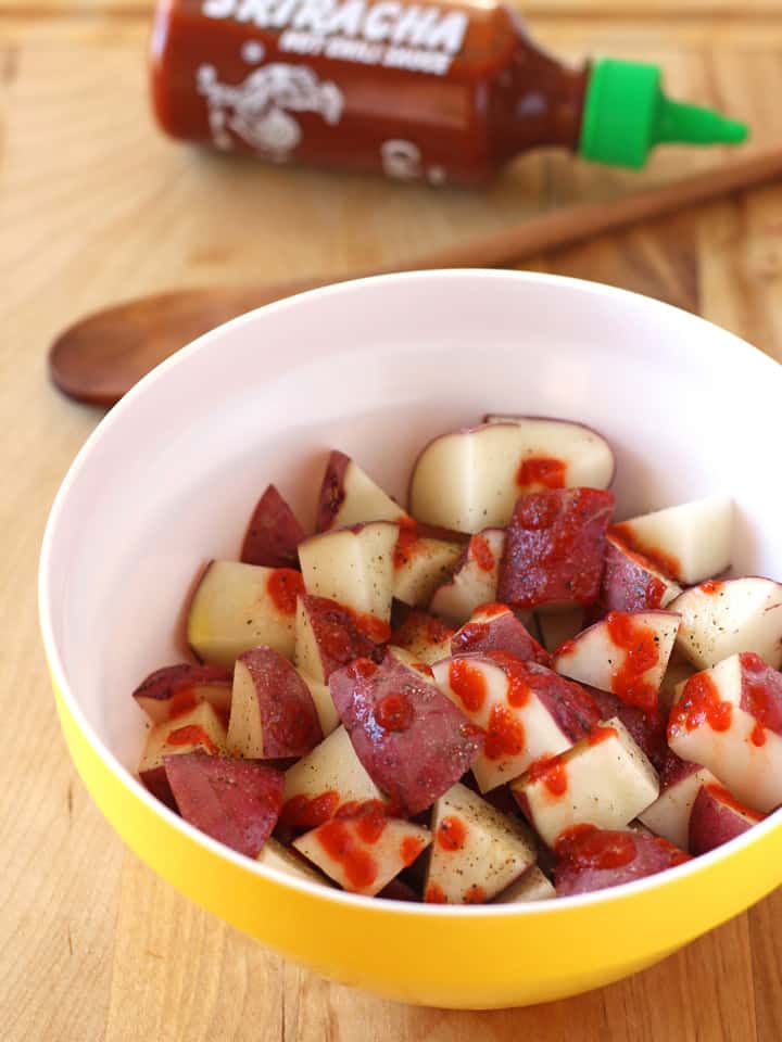 Spicy Sriracha Roasted Red Potatoes. Lightly crispy on the outside and creamy on the inside spicy roasted potato bites. The prefect addition to a weekend breakfast or late night burrito bowl.
