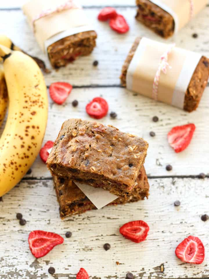 Banana bread bars surrounded by freeze-dried strawberries and mini chocolate chips.
