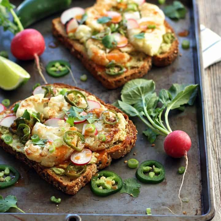 Spicy Avocado Cauliflower Toasts. Make lunchtime exciting with these crispy, creamy, hot and spicy veggie topped toasts. Enjoy one and share the other with your favorite jalapeno loving friend.