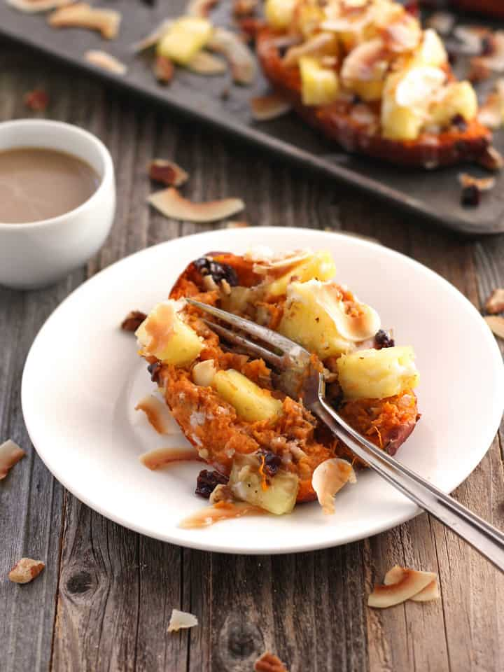 Vegan Twice-Baked Sweet Potatoes with Pineapple and Coconut. Top baked sweet potatoes with fresh pineapple, toasted coconut and creamy coconut butter for a healthy and indulgent spring breakfast, lunch or dinner.