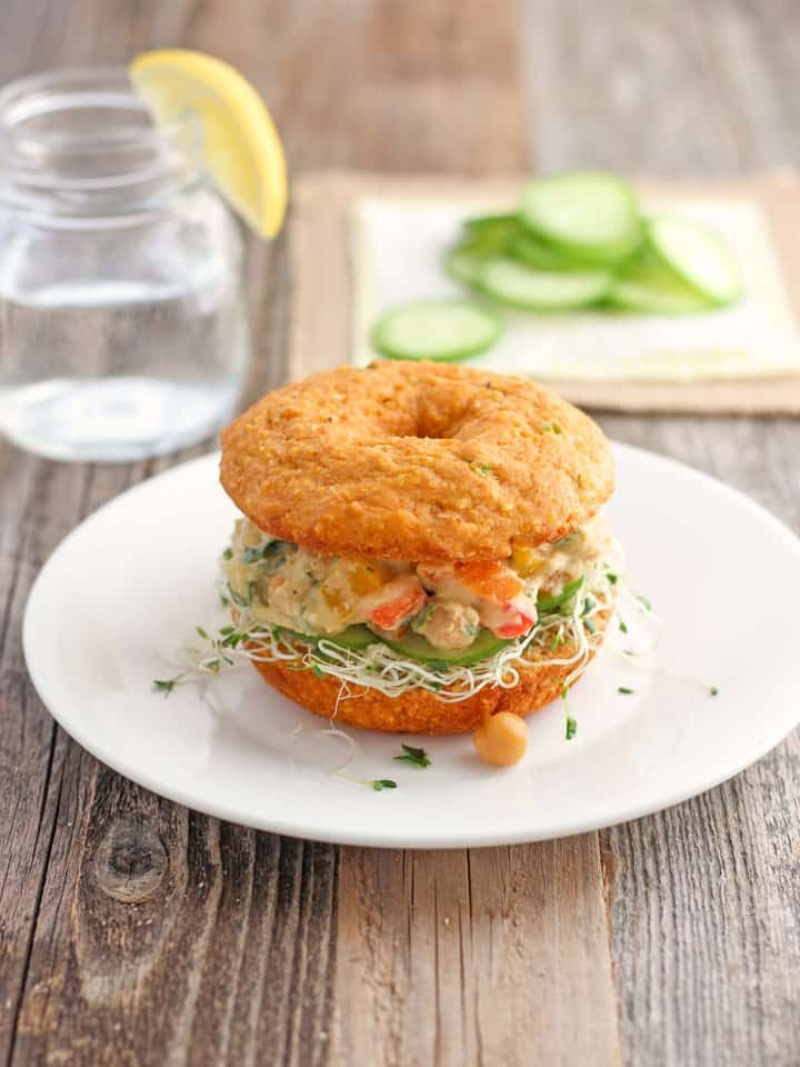 Cornbread Veggie Sandwich. Treat yourself to a tasty lunch of creamy hummus, chickpeas and lots of crisp fresh veggies sandwiched in a savory Cheddar Sriracha Cornbread Donut