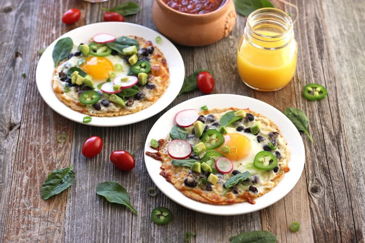 Baked Egg Tostadas. An easy high protein toaster oven breakfast. Load them up with fresh toppings like spinach, tomatoes and salsa for a filling start to your day!