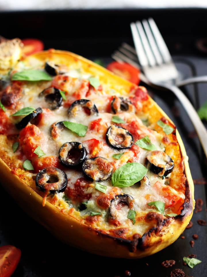 Veggie Pizza Spaghetti Squash Boats are serious comfort food that's secretly wholesome. Toaster oven roasted spaghetti squash stuffed with ricotta and kale then covered in your favorite vegetarian pizza toppings.