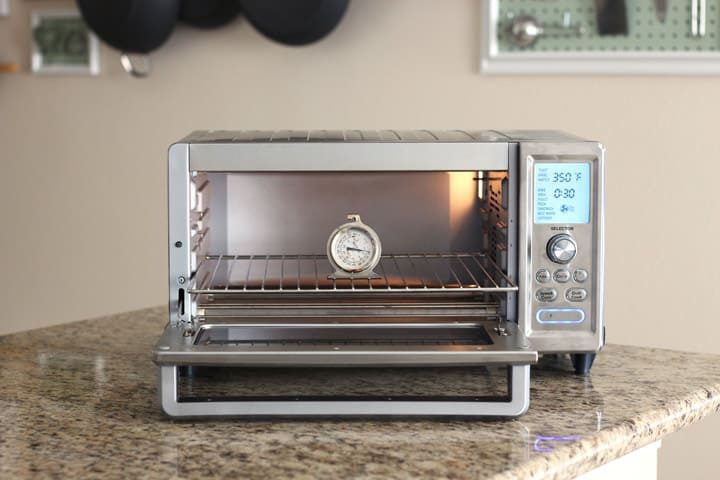 Thermometer on a cooking rack inside a toaster oven.
