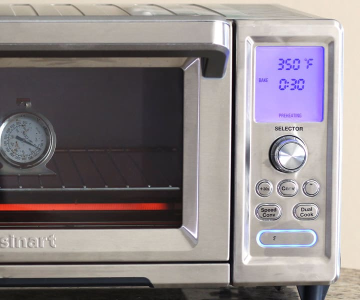 Closeup of control panel on a large toaster oven.