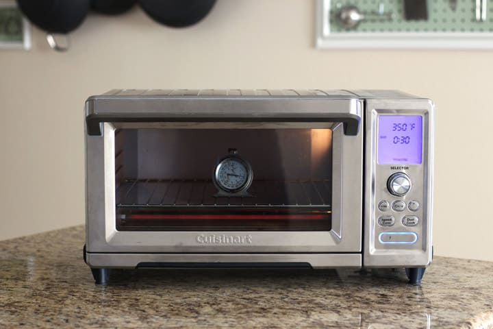 Large countertop oven with an oven thermometer inside.