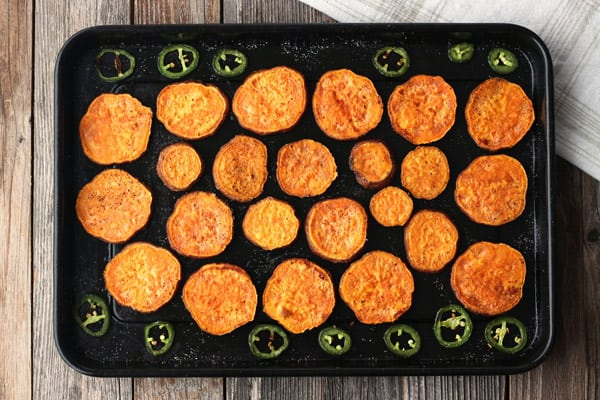 Sweet potato nachos are lightly crispy on the outside, tender on the inside and simple to cook in a toaster oven. Make them extra special and spicy with roasted jalapeño slices.