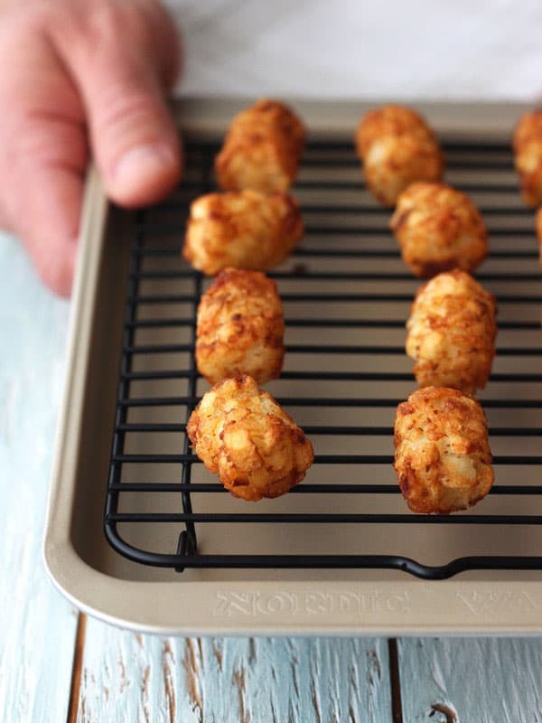 Bake frozen tater tots in your toaster oven for a fun single serving treat. Use a mini baking rack to get them extra crispy without any added oil.