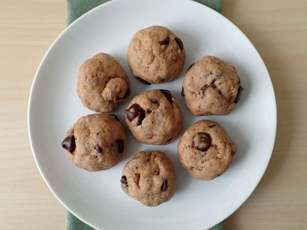 A small white plate with chocolate chip cookies.