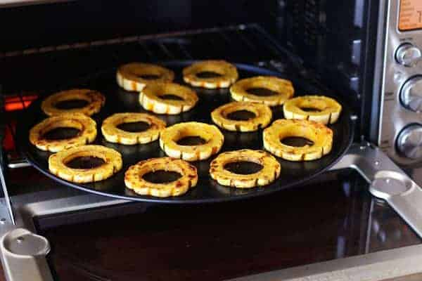 Roasted slices of delicata squash in a toaster oven