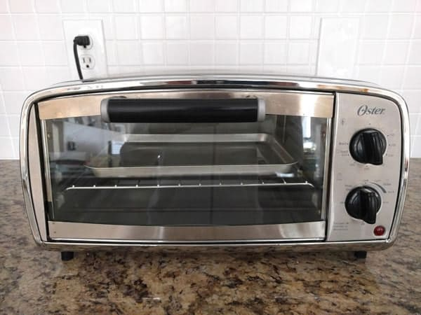 Small toaster oven on a kitchen counter.