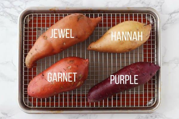Raw Garnet, Jewel, Hannah, Purple sweet potatoes on a baking rack