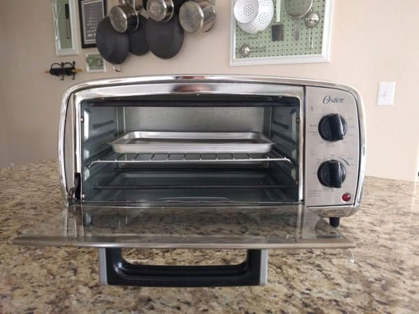 Oster TSSTTVVGS1 toaster oven on a kitchen counter.