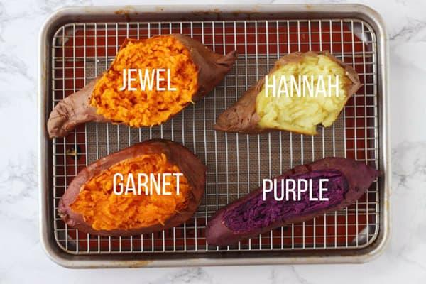 Baked Garnet, Jewel, Hannah, Purple sweet potatoes on a baking rack