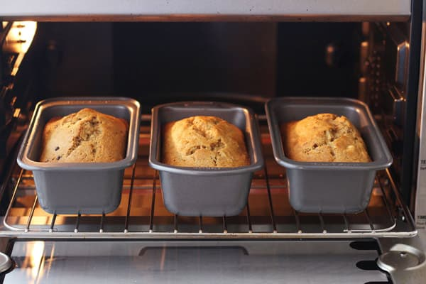 2 baked mini loaves side by side on a rack in the toaster oven