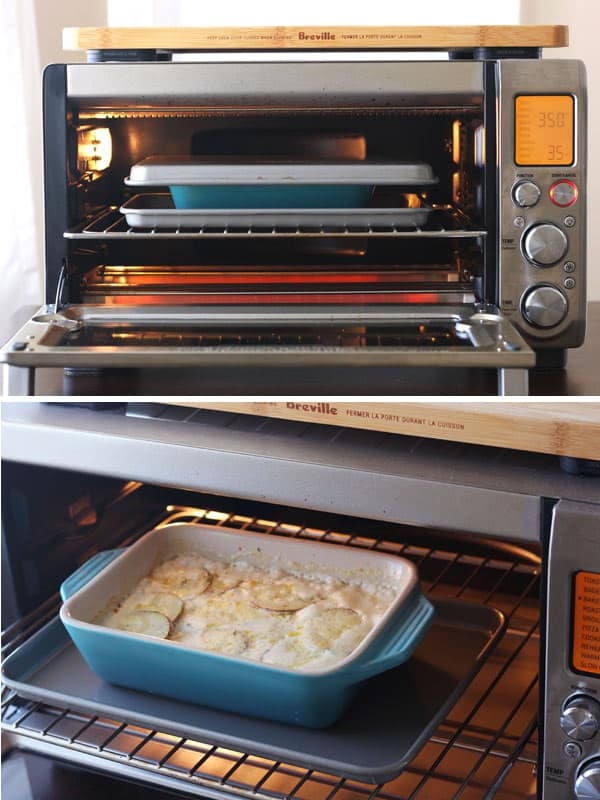 A dish of potatoes au gratin baking in the toaster oven.