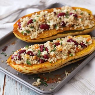 Filled delicata squash boats on a toaster oven baking pan.