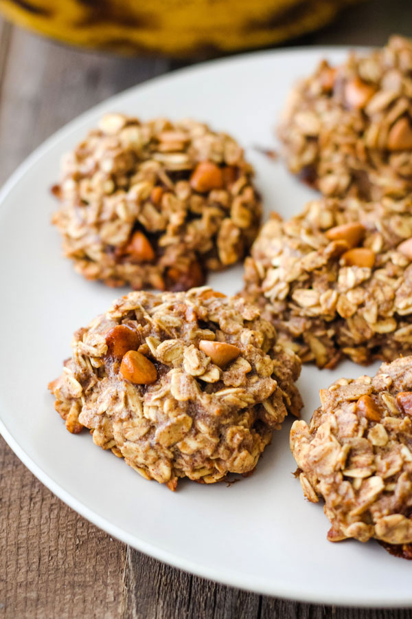 Banana oatmeal cookies on a white plate.