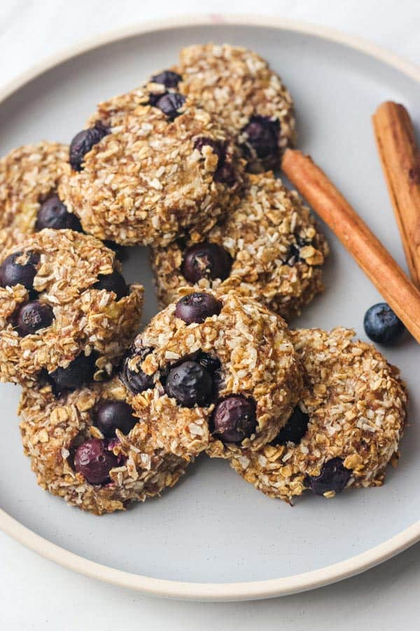 Closeup of blueberry banana oat cookies on a blue plate.