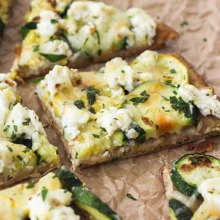 Piece of broiled zucchini and lemon flatbread
