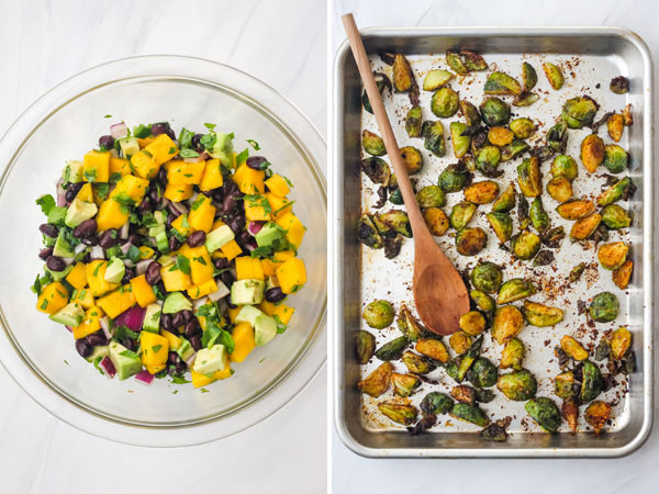 A glass bowl of avocado mango salsa and a sheet pan of roasted Brussels sprouts.