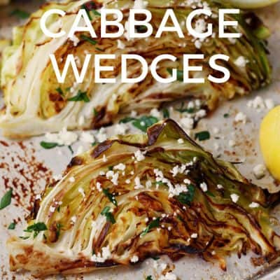 Roasted cabbage wedges on a quarter sheet pan.