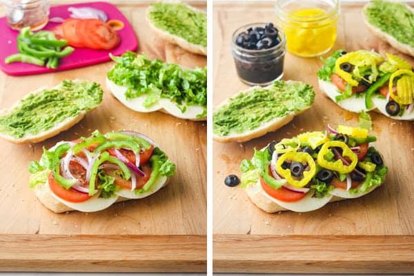 Cutting board with sandwich rolls and fresh veggies.