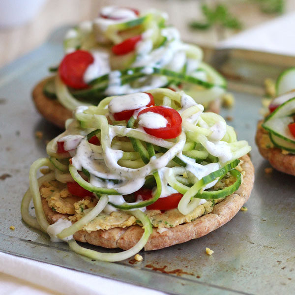 Small sheet pan with mini pita topped with spiraled cucumber.