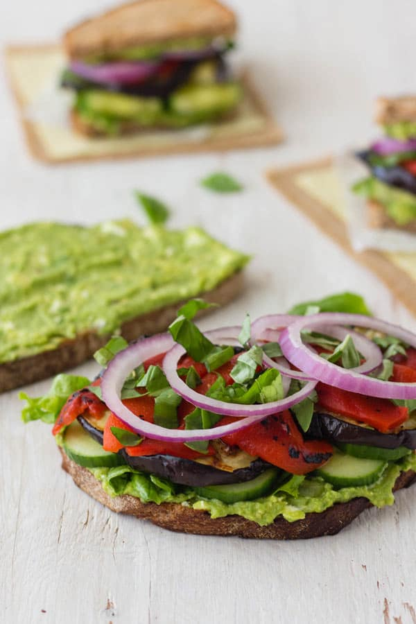 Broiled eggplant slices, fresh red onions, roasted peppers, cucumbers and mashed avocado layered on two slices of toasted bread
