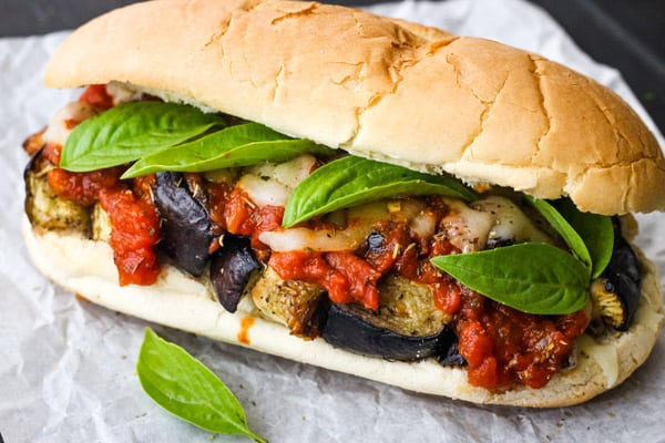 Hoagie with cheese and tomato sauce.