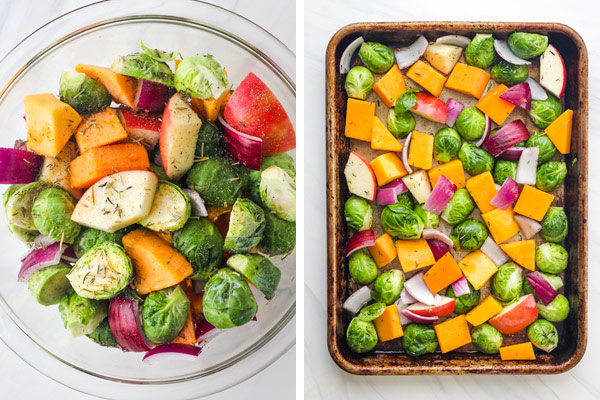 A glass bowl of chopped vegetables and a sheet pan with chopped Brussels sprouts, squash, onion, and apple.