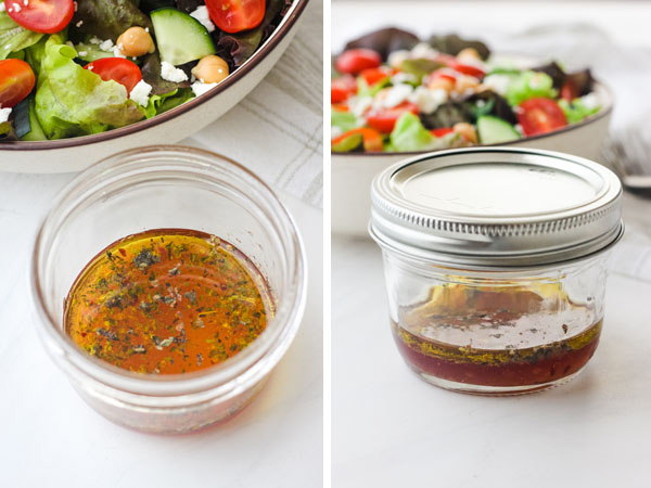 Small mason jar with salad dressing with a green salad in the background.