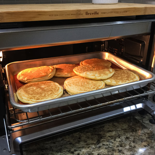 A pan of pancakes inside a toaster oven.